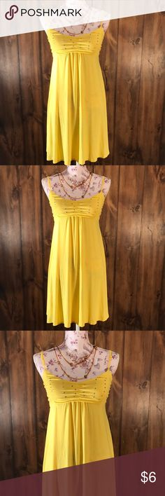 Yellow Dress Bright yellow dress Stretchy and comfy  Like new Size M  Adjustable straps Bra area is padded Dresses