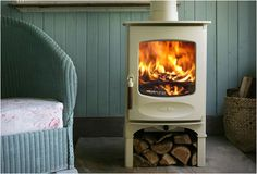 björn and i had been debating about a fireplace versus a wood stove versus not having anything at all. he grew up with a wood burning stove. Tiny Wood Stove, Small Stove, Small Wood Stoves, Small Wood Burning Stove, Mini Stove, Stove Fireplace, Porch Fireplace, Country Fireplace, White Fireplace