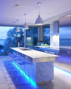 Futuristic Kitchen Design With Blue Lighting.