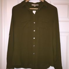 Loft Button-up Blouse Olive green color. Long sleeve blouse. Button-up. Collar. Never used, new with tags. If you have questions or need additional pictures let me know. No trades! Make me an offer! LOFT Tops Button Down Shirts