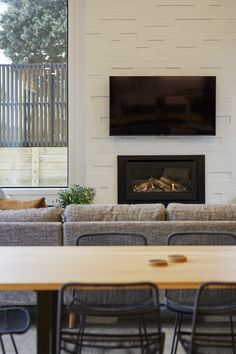 A gas fire sits centre of the living space with the feature painted brick from the exterior creating connection with the interior. Calley Homes Loft Spaces, Living Spaces, Exposed Rafters, Chimney Cap, Building Companies, Bedroom With Ensuite, Gas Fires, Guest Bedrooms, Concrete Floors