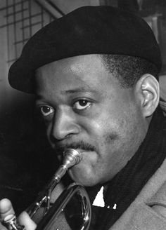 """""""My heart heard heaven, he was playin� his sweet trumpet on the sidewalk; He had one foot in the gutter but his soul was free.   His blissful solo, just floated all around him the darkness, and each note was as clear as can be."""" -Laurie Early [One Foot in the Gutter  music c. Clark Terry, [photo 1955]"""