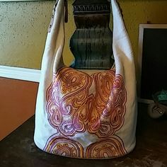"Jessica Simpson Hobo Pretty canvas hobo with a beautiful pink and orange embroidery on the front. Zip top closure. Interior clean. Side of bag has a blue spot as seen in pic 4 the bottom shows wear. Strap drop is 15"" Jessica Simpson Bags Hobos"