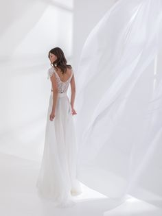 Off white crop top dress made with French lace, with a bateau neckline and a chiffon skirt, decorated with feathers on the sleeves Crop Top Dress, Bateau Neckline, Chiffon Skirt, Bridal Wedding Dresses, French Lace, Dress Making, Off White, Couture, Crop Tops