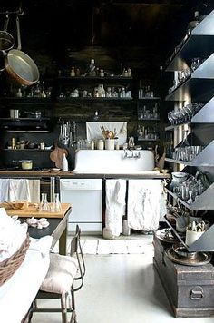 love this kitchen with the open shelving & vintage sink