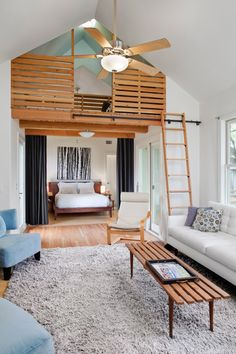 Loft was created by lifting up a roof section in the middle of the building. The rolling library ladder adds fun to the space efficient design. Loft divides living room & kitchen from the bedroom & bath areas