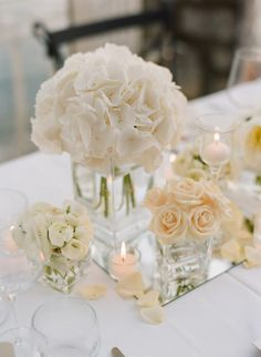 White and Pale Peach Flower Arrangements in Clear Glass Vases