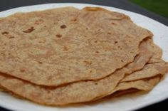 whole-wheat tortillas 2½ cups whole-wheat flour (2 over full cups wheat berries, process twice on speed 9) Transfer to Kitchen Aid Mixer , add ½ cup oil drizzled while mixing and 1 teaspoon salt. Add extra flour you have on hand if it doesn't look crubly. Then with dough hook and slowly add 1 cup very warm water and knead 3 minutes. Makes 12 large thin flour tortillas. Cook 45 seconds per side on hot griddle