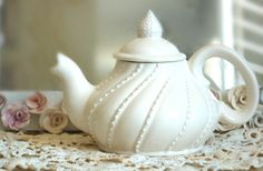 Cream white lace teapot with a swirled design by Dprintsclayful I don't even drink tea often I just think its do pretty