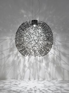 Explosion of lighting. We just love this idea.  What do you think?  See all collection on our blog.  #lightingstore, contemporary lighting design, #interiordesign, chandelier