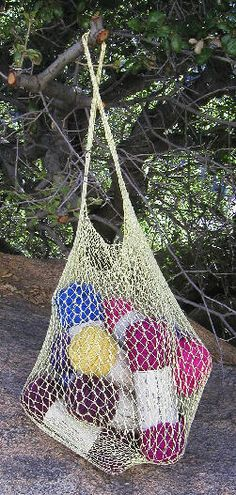 [Knitted string bag holding 8 skeins of Lamb's Pride Bulky]