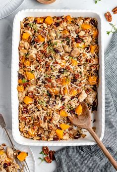 Cozy and delicious butternut squash, chicken and wild rice casserole made with nutty wild rice, sweet butternut squash, tangy dried cranberries and plenty of parmesan cheese. You'll love this warming, protein-packed wild rice casserole during the fall and winter months! #rice #casserole #butternutsquash #glutenfree #healthydinner #fallrecipe #familydinner...