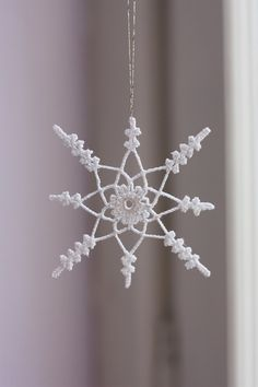Beautiful inspiration to your own snowflakes this winter season. Find some worsted weight yarn or even cotton thread to make unique snowflakes to hang inside your home. by stella Crochet Stars, Crochet Snowflakes, Christmas Snowflakes, Thread Crochet, Crochet Motif, Diy Crochet, Crochet Crafts, Crochet Flowers, Crochet Stitches