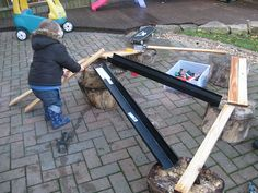 J was into cars today, so when we went outside we thought we would take them with us! The planks of wood are a new addition to our outdoor a...