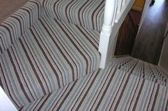 Example of striped stair turn Wood And Carpet Stairs, Striped Carpet Stairs, Patterned Stair Carpet, Striped Carpets, Oak Stairs, White Stair Risers, Stair Wall Decor, Stairs Colours, Home Stairs Design