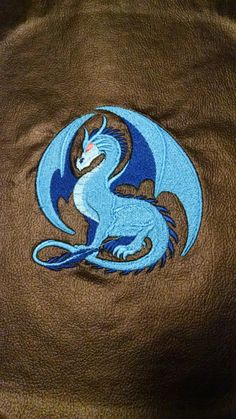 Blue dragon on black vinyl.
