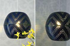 Double passoir Du matériau perforé design noir
