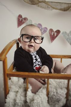 My son is way too adorable LOL! Custom made onesie, and photo prop glasses...classic Valentine's photo!