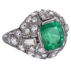 An Art Deco ring with an emerald to the centre, framed by four baguette cut diamonds and pavé-set round brilliants in a platinum mount of geometric, slightly bombé design typical of the Art Deco Diamond Rings, Diamond Art, Art Deco Ring, Art Deco Jewelry, Emerald Diamond, Fine Jewelry, Jewelry Rings, Diamond Jewellery, 1920s