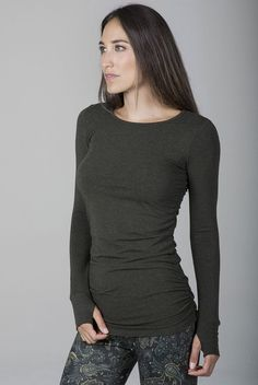 Add classic style to your wardrobe with the Side Ruched Long Sleeve Top from Kira Grace. This Forest Night Heather colored long sleeved top features full length sleeves, thumbholes, and super flattering ruching on the sides, boasting effortlessly chic sty Tie Shorts, Yoga Tops, Hot Pants, Yoga Bra, Black Tops, Long Sleeve Tops, Active Wear, Dress Up, Night
