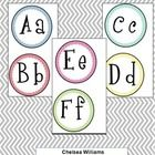 This is a set of Word Wall letters. The letters are in black and the circle backgrounds are in blue,red, teal, yellow, pink, and green with a Chevr...