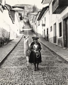 vintage photography - Beautiful lady with her alpaca in Peru