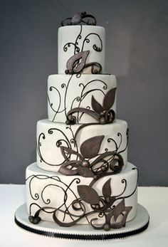 Really beautiful designs. I like the color, but of course, it may not match the rest of the wedding. Perhaps a brighter color instead of brown?    colette's cakes | decorative cakes for all occasions