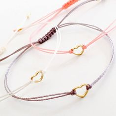 Gold heart bracelet, tiny bracelet, friendship bracelet, gift jewelry This is very elegant bracelet. Great gift for any occasion!!!  This listing is for one bracelet.  Details:  ♥ Tiny heart charm (6.7x6.2mm) ♥ Nylon waxed cord (0.5mm) ♥ The bracelet is adjustable ♥ Two gold plated