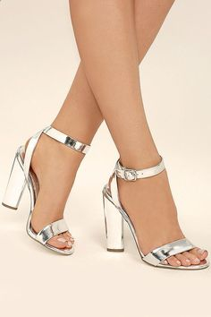 We'll always cherish the Steve Madden Treasure Silver Leather Ankle Strap Heels! Metallic silver leather is formed to a classic single sole silhouette with peep-toe upper, and crisscrossing ankle strap with matching buckle. Silver Heels Prom, Prom Heels, Silver Shoes, Metallic Shoes, Lace Up Heels, Ankle Strap Heels, Ankle Straps, Stilettos, Pumps Heels
