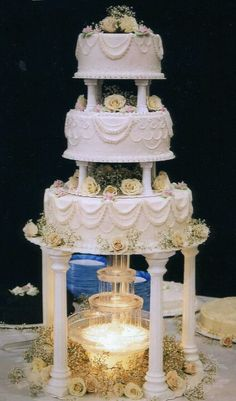 wedding cakes with fountain monogrammed wedding cake with glass pillars filled with 26024