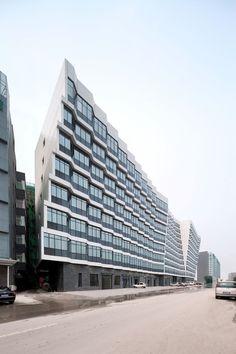 Dongrun Apartment Building / Praxis dArchitecture