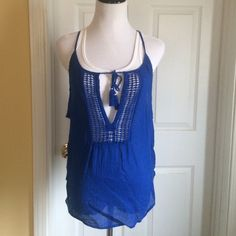 Hollister tank M Super cute flowy tank with tie front and tassels. Very thin. 100% cotton. Gorgeous blue.  Pics are taken with white Hollister tank underneath that's not included Hollister Tops Tank Tops