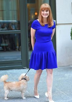 Jessica Chastain is all smiles while stepping out with her dog on August 27, 2014 in New York City, New York.