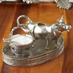 Silver Cow Creamer Set...my grandmother MiMi would have thought this was a hoot;)