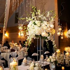 combination of candles in pillar vases and white florals