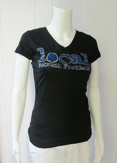 Local Football Tee | Show your Lions spirit in our local football tee.  Women's Slim Fit.  V-Neck.  Short Sleeve.  50% Cotton/50% Polyester.  Sizes S-XL. | Willy & Babbish Boutique | New Baltimore, MI
