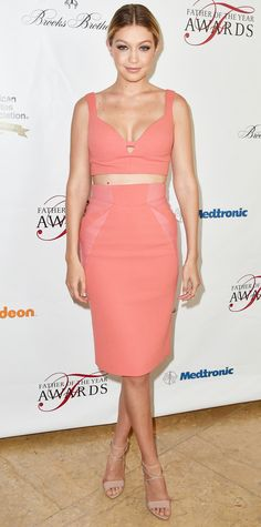 Gigi Hadid in a coral bustier and a matching pencil skirt