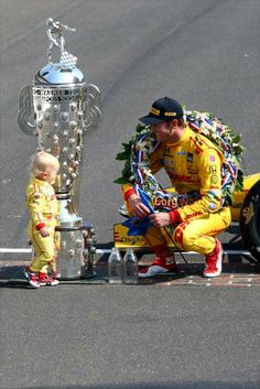 Ryan Hunter-Reay with his son Ryden on the yard of bricks 5-26-14