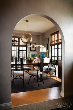 Cool globe chandelier and interesting black chairs