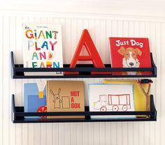 Decluttering tips for kids' rooms: Place a few favorite books on a ledge shelf with covers facing out, to make putting them away even easier