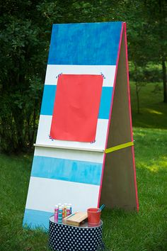 {DIY Giant Art Easel and Craft Center} How fun would this be outside? Other side is a giant chalkboard