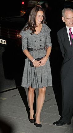 Kate in grey pleated skirt with black detail accents