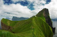 Kallur, Faroe Islands - 2014 - Kallur lighthouse on Kalsoy island.  I took this picture in the Faroe Islands and thanks to VisitFaroeIslands and National Geographic it got pretty famous but I almost never saw the wide angle of it, it's always been cropped. Here is the full version!
