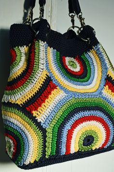 """Zoe Crochet Purse By The Sak Rainbow Colors Satin Lined in Navy Magnetic Snap Closure Inside Zipper Pocket Measurements: Approx 12"""" h x 11"""" w Strap 10"""""""