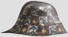 A painted sallet,  modern replica in the style of circa 1500. Hammered and ridget skull made of two pieces with the characteristic tapering neck guard. Two small dents on the left side. Pivoted visor with divided sight. A surrounding row of fine double holes. Painted in colour with heraldic motifs, heavily worn. Height 22 cm.