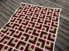 """Ravelry: Project Gallery for Modern Mitered Granny Square pattern by Sue Rivers- love the """"quilty-ness"""""""