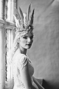 Bride with feather headdress | Laura Power Photography | see more on: http://burnettsboards.com/2014/07/eclectic-wedding-historic-manor-house/