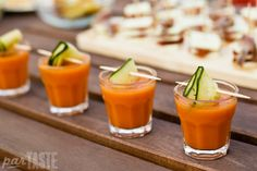 Gazpacho Shooters with Marinated Cucumber Ribbons Recipe - a refreshing appetizer inspired by the classic Andalusian tomato soup that is easy to make and can be prepared in advance for large parties.