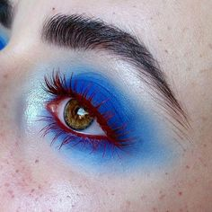 Blue smokey eye with rusty red mascara and eyeliner