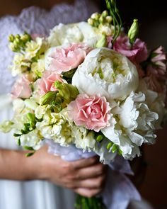 Romantic Bouquet    A family handkerchief is wrapped around the base of this lush arrangement of pink lisanthus and white peonies with stock